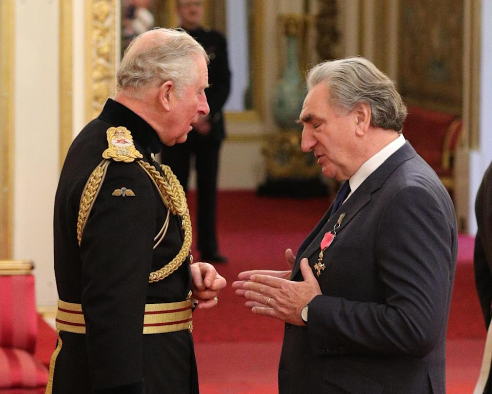 Chatting to Prince Charles as he receives the award – credit PA.