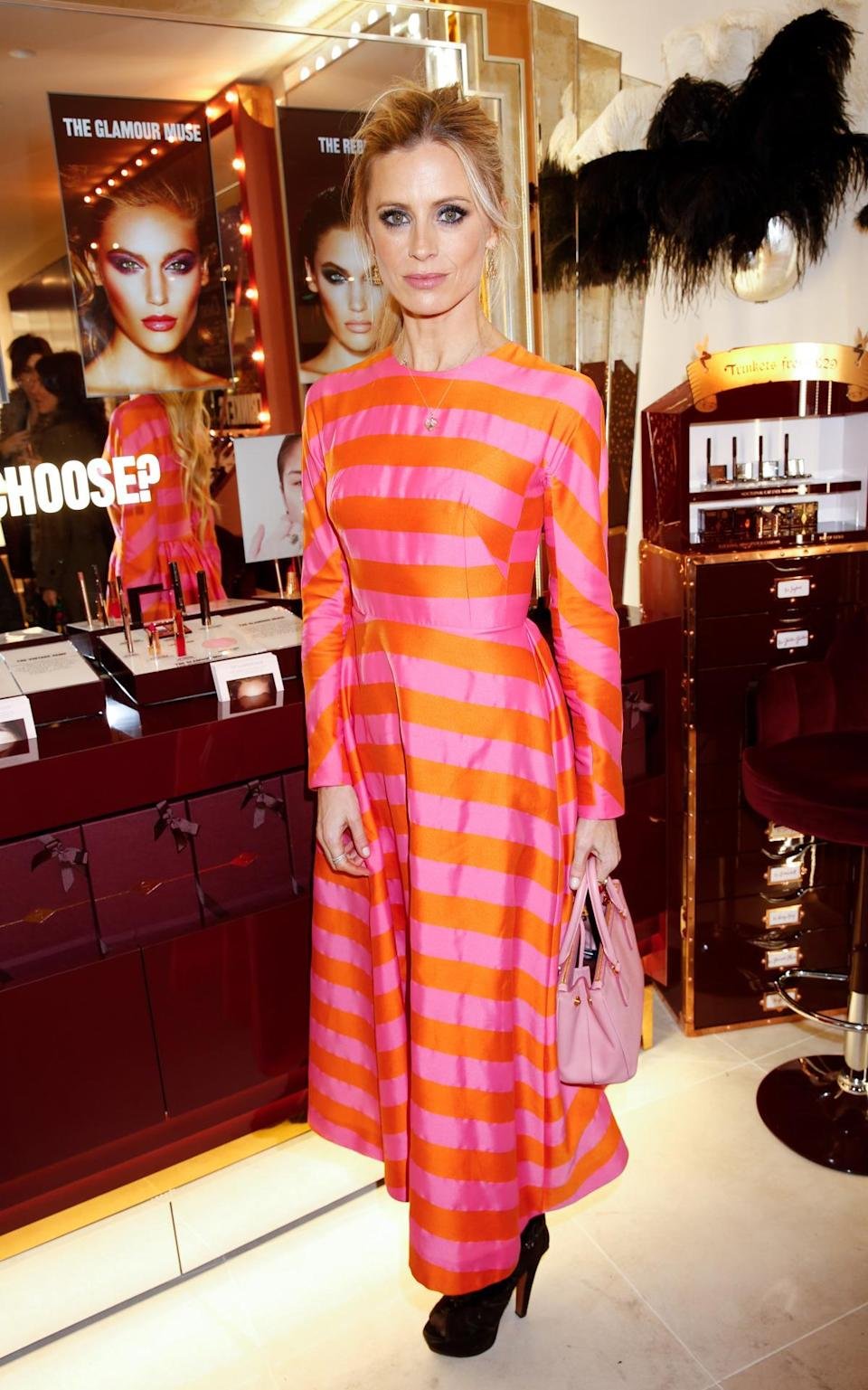 Laura Bailey was the most brightly dressed in a striped pink and orange long-sleeved dress. [Photo: Rex]