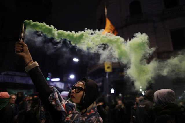 <p>A woman in support of decriminalizing abortion spreads colored smoke outside Congress after lawmakers voted against an abortion bill in Buenos Aires, Argentina, early Thursday, Aug. 9, 2018. (Photo: Natacha Pisarenko/AP) </p>