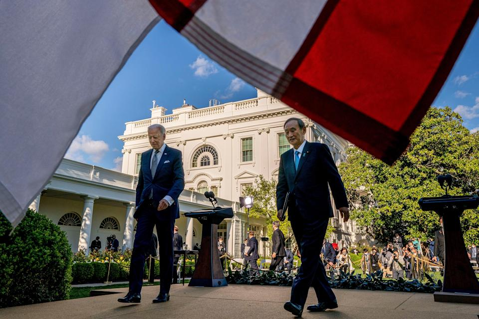 President Joe Biden and Japanese Prime Minister Yoshihide Suga leave a news conference in the Rose Garden of the White House in Washington, Friday, April 16, 2021.
