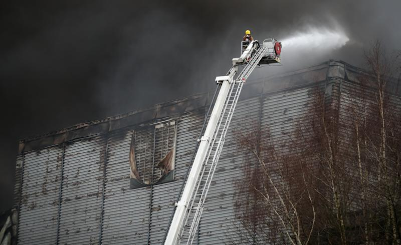 Firefighters at the scene of Ocado robotic warehouse in Andover, Hampshire after a huge blaze that swept through the building was brought under control.
