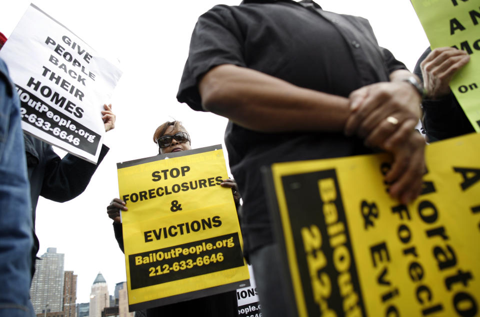 People protest outside the entrance for the Real Estate Disposition Corp (REDC) Foreclosure Home Auction in New York, March 8, 2009. The auction of foreclosed homes in New York City on Sunday drew protesters who blamed banks for an epidemic of home losses and called for a moratorium on evictions and foreclosures.  REUTERS/Shannon Stapleton   (UNITED STATES BUSINESS CONFLICT IMAGE OF THE DAY TOP PICTURE)