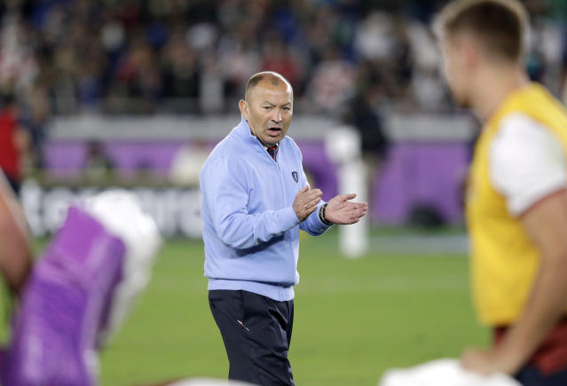 England coach Eddie Jones watches his players prepare before the Rugby World Cup final at International Yokohama Stadium between England and South Africa in Yokohama, Japan, Saturday, Nov. 2, 2019. (AP Photo/Aaron Favila)