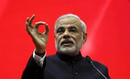 "Gujarat's chief minister Narendra Modi speaks during the ""Vibrant Gujarat Summit"" at Gandhinagar in Gujarat January 12, 2013. REUTERS/Amit Dave/Files"