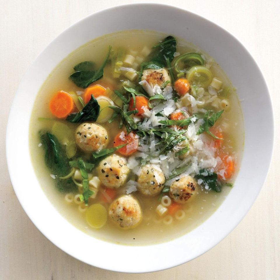"""A simple, satisfying dinner for a rainy night. A garnish of chopped basil and Parmesan adds rich, bright flavor. <a href=""""https://www.epicurious.com/recipes/food/views/spring-minestrone-with-chicken-meatballs-395039?mbid=synd_yahoo_rss"""" rel=""""nofollow noopener"""" target=""""_blank"""" data-ylk=""""slk:See recipe."""" class=""""link rapid-noclick-resp"""">See recipe.</a>"""