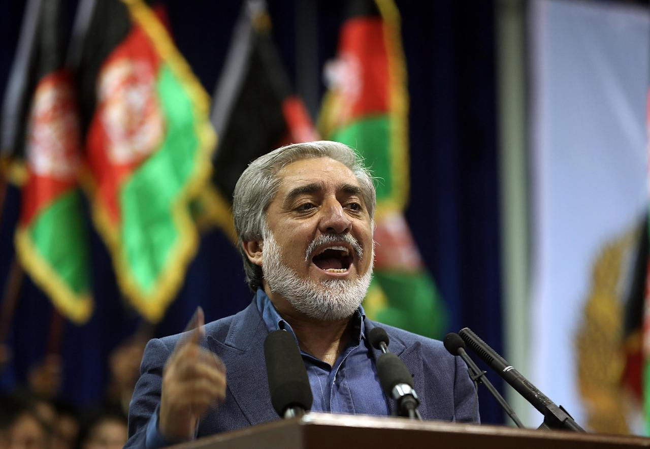 Afghan presidential candidate Abdullah Abdullah speaks during a gathering of his supporters in Kabul, Afghanistan, Tuesday, July 8, 2014. Abdullah says he received calls from President Barack Obama and U.S. Secretary of State John Kerry after he refused to accept the preliminary result of the vote citing fraud. Abdullah told his supporters the results of the election were fraudulent but asked them to give him a few more days to negotiate. (AP Photo/Massoud Hossaini)