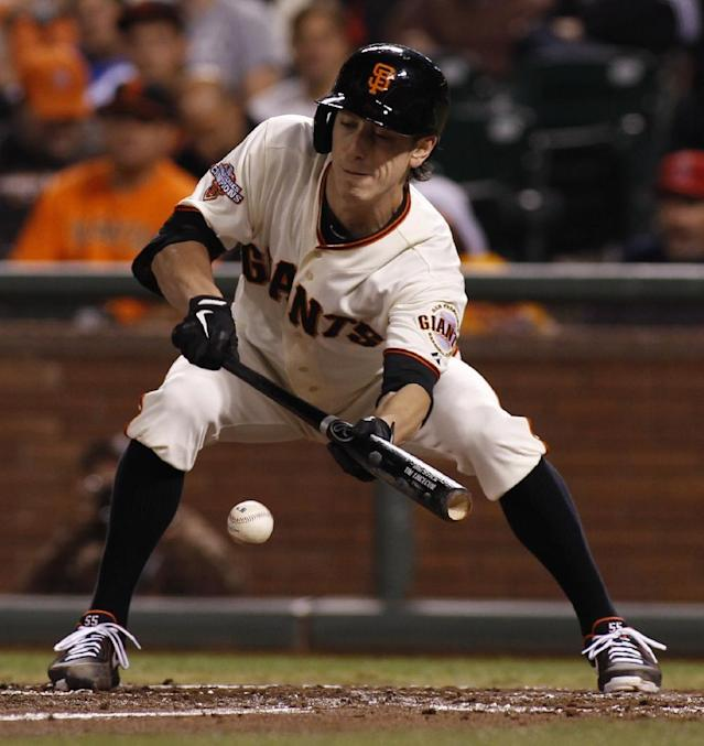 San Francisco Giants' Tim Lincecum lays down a sacrifice bunt against the Los Angeles Dodgers during the fifth inning of a baseball game in San Francisco, Thursday, Sept. 26, 2013. (AP Photo/George Nikitin)