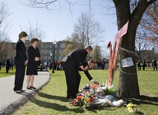 PHOTO: President George W. Bush and  Virginia Governor Timothy M. Kaine pay respects at a makeshift memorial on the campus of Virginia Tech University, April 17, 2007, one day after a shooting massacre at the facility in Blacksburg, Virginia. (Mandel Ngan/AFP via Getty Images, FILE)