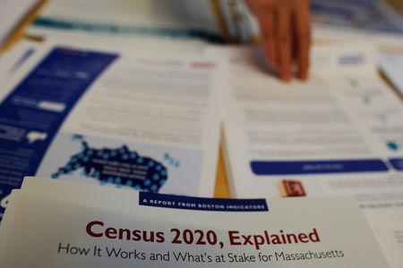 Informational pamphlets are displayed an event for community activists and local government leaders to mark the one-year-out launch of the 2020 Census efforts in Boston, Massachusetts, U.S., April 1, 2019. REUTERS/Brian Snyder