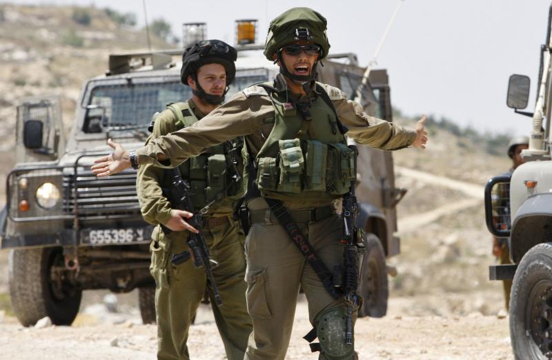 Israeli soldiers patrol the West Bank City of Hebron