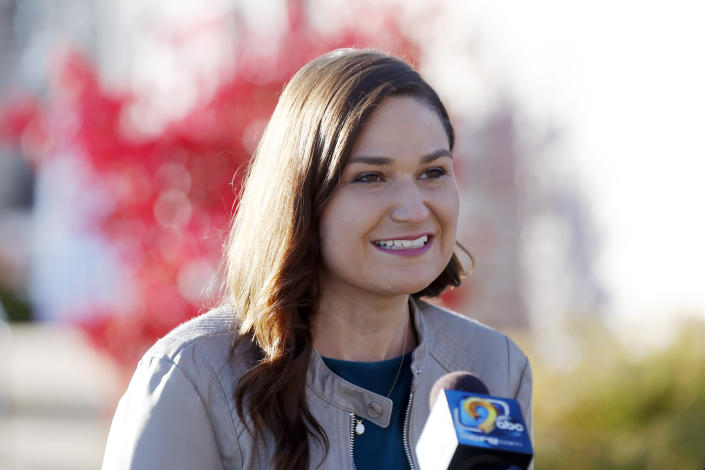 FILE - In this Nov. 3, 2020 file photo, Abby Finkenauer talks with journalists at the Linn County Democrats' office in Cedar Rapids, Iowa. Democrat Abby Finkenauer, a former congresswoman, is running for Republican Chuck Grassley's U.S. Senate seat, hoping her blue-collar credentials will propel her forward in a state that has grown more conservative over the years. (Liz Martin/The Gazette via AP)