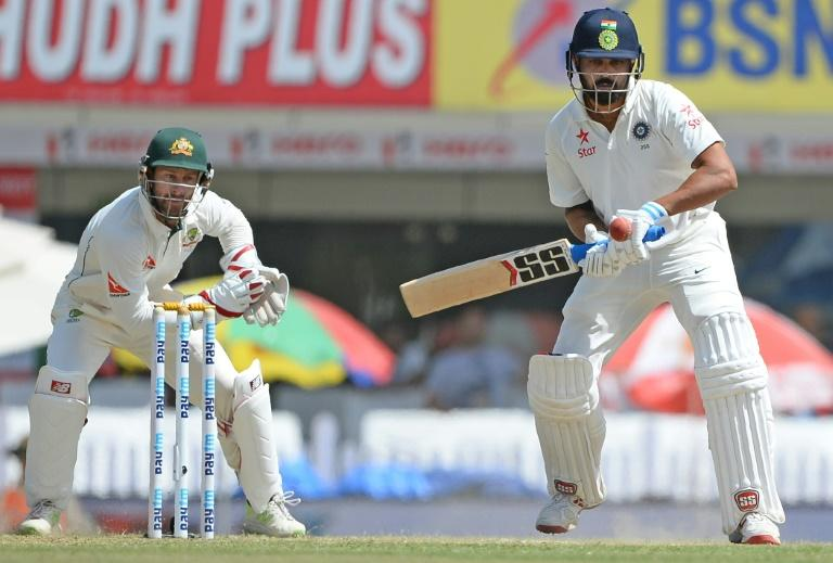 Indian batsman Murali Vijay plays a shot as Australian wicketkeeper Matthew Wade looks on on the third day of their 3rd Test match, at the Jharkhand State Cricket Association (JSCA) Stadium complex in Ranchi, on March 18, 2017