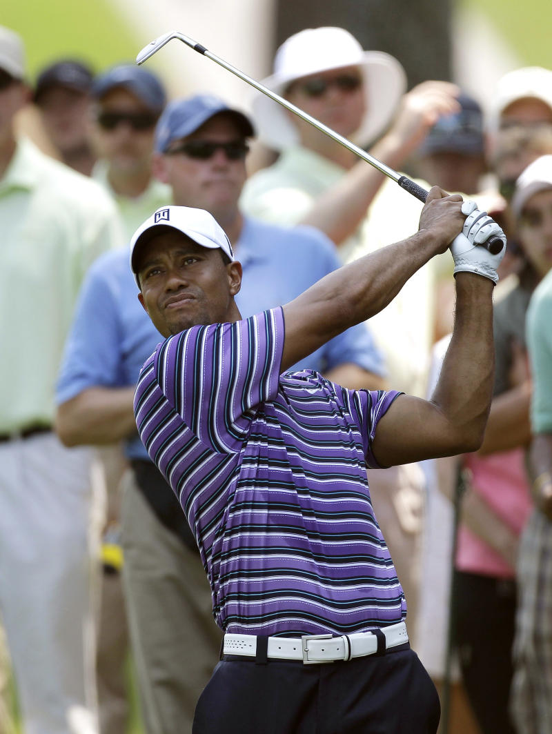 Tiger Woods hits his approach shot from near the gallery during a practice round for The Players Championship, Tuesday, May 10, 2011, in Ponte Vedra Beach, Fla. (AP Photo/Chris O'Meara)