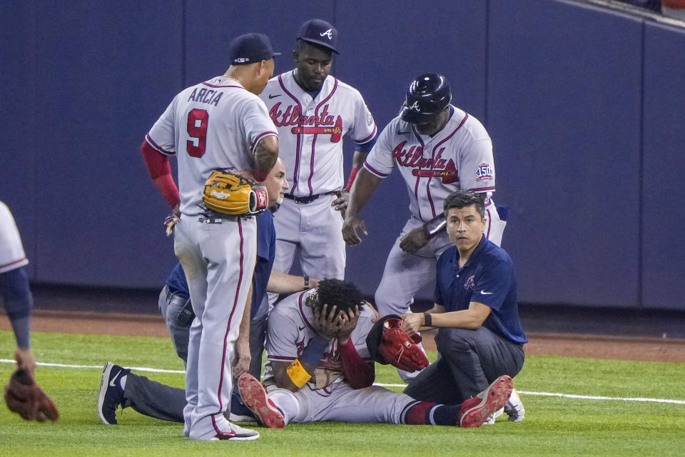MIAMI, FL - JULY 10: Ronald Acuna Jr. #13 of the Atlanta Braves sits with his head in this hands after an injury during the fifth inning against the Miami Marlins during the fifth inning against the Miami Marlins  at loanDepot park on July 10, 2021 in Miami, Florida. (Photo by Eric Espada/Getty Images)