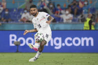 Italy's Lorenzo Insigne scores his side's third goal during the Euro 2020 soccer championship group A match between Italy and Turkey at the Olympic stadium in Rome, Friday, June 11, 2021. (Alberto Lingria/Pool Photo via AP)