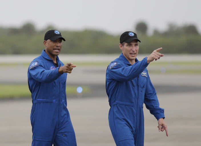NASA Astronauts Victor Glover and Michael Hopkins walk from their airplane after arriving at the Kennedy Space Center, Sunday, Nov. 8, 2020, in Cape Canaveral, Fla. Four astronauts will fly on the SpaceX Crew-1 mission to the International Space Station scheduled for launch on Nov. 14, 2020 (AP Photo/Terry Renna)