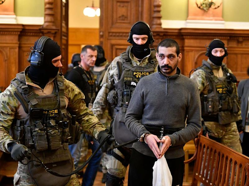 Syrian man identified as F Hassan, who is on trial for alleged terrorist activities, arrives at the Metropolitan Court in Budapest: EPA/Zsolt Szigetvary Hungary Out