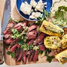 <p>An herbaceous butter turns grilled sweet corn into a rave-worthy accompaniment to simple grilled flank steak.</p>