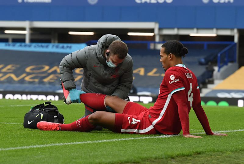 Liverpool's Virgil van Dijk was injured on a tackle by Everton goalkeeper Jordan Pickford during Saturday's Merseyside derby. (John Powell/Getty Images)