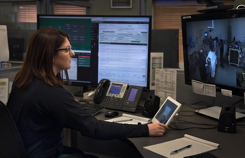 SIOUX FALLS, SD- OCTOBER 17: Hannah Schulte, RN has a quiet moment after a patient had passed away on October 17, 2019. She's just about to turn off the live camera that connected her (and other colleagues) to an emergency room staff in the midwest where a patient that was in very critical condition on arrival was not able to be revived. As hospitals and physicians continue to disappear from rural America there is an attempt to fill the void: a telemedicine center run by Avera Health that provides remote emergency care for more than 175 understaffed hospitals across thirty states. Physicians work out of high-tech cubicles instead of exam rooms. They wear scrubs to look the part of traditional doctors on camera, even though they never directly see or touch their patients. They respond to hundreds of emergencies each month using remote controlled cameras and computer screens at what has become rural Americas busiest hospital, which is in fact a virtual hospital located in a suburban industrial park. (Photo by Michael S. Williamson/The Washington Post via Getty Images)