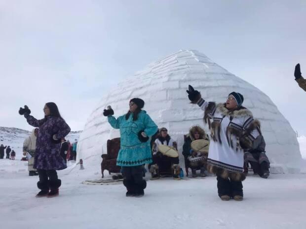 Drum singers and dancers perform at the 2021 Qaggiq Festival in Iqaluit, Nunavut in March.  (Pitseolak Pfeifer/Facebook - image credit)