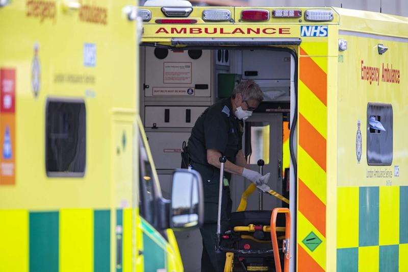 A London Ambulance worker cleans an ambulance outside of the Royal London Hospital: Getty Images