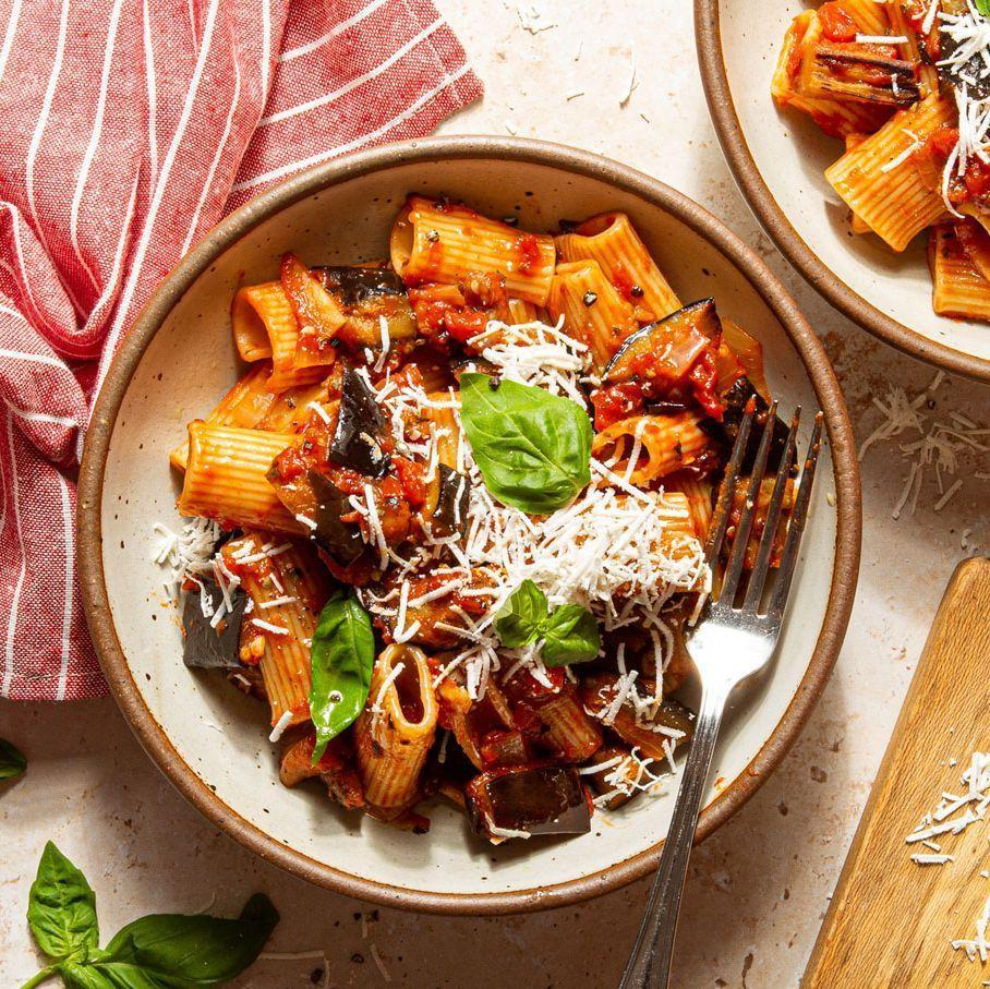 """<p>Pasta all Norma is an easy Sicilian pasta dish with aubergine that is essentially pan-fried and lots of ricotta salata. A quick marinara sauce is made for this dish, which uses the oil that the aubergine is cooked in and adds such great flavour to the sauce. </p><p>Get the <a href=""""https://www.delish.com/uk/cooking/recipes/a34503638/pasta-alla-norma-recipe/"""" rel=""""nofollow noopener"""" target=""""_blank"""" data-ylk=""""slk:Pasta alla Norma"""" class=""""link rapid-noclick-resp"""">Pasta alla Norma</a> recipe.</p>"""