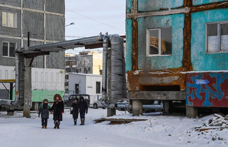 In the Siberian city of Yakutsk, buildings have started to sag and crack as the ground literally shifts beneath them. (AFP Photo/Mladen ANTONOV)