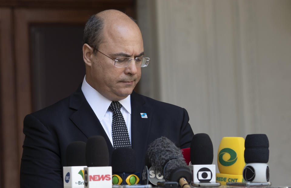 Rio de Janeiro Governor Wilson Witzel pauses as he speaks to journalists at the Laranjerias palace in Rio de Janeiro, Brazil, Tuesday, May 26, 2020. Brazil's Federal Police searched Witzel's official residence on Tuesday, part of an investigation into the alleged embezzlement of public resources in the state's response to the COVID-19 pandemic. (AP Photo/Silvia Izquierdo)