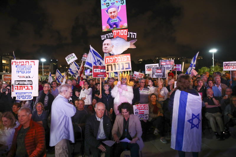 Protesters hold banners during a rally calling for the resignation of Israel's Prime Minister Benjamin Netanyahu, in Tel Aviv, Israel, Saturday, Nov. 30, 2019. (AP Photo/Oded Balilty)