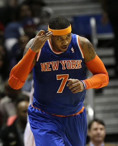 New York Knicks forward Carmelo Anthony gestures after scoring a basket in the first half of an NBA basketball game against the Atlanta Hawks on Wednesday, Nov. 13, 2013, in Atlanta. (AP Photo/John Bazemore)