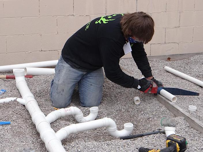 Plumbing student Ryan Hammond works on his entry at the Skills USA state competition in April. (Patrick O'Donnell)