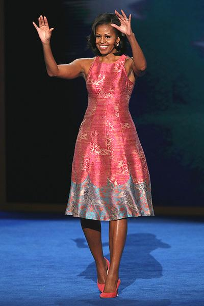 The First Lady looked pretty in a pink and blue floral dress and matching J. Crew Everly suede pumps. It just goes to show that women can look fashionable without spending a lot of money.  Obama has shown her love for countless American designers such as Ralph Lauren, Vera Wang and Rodarte, to name a few.  (Photo by Alex Wong/Getty Images)
