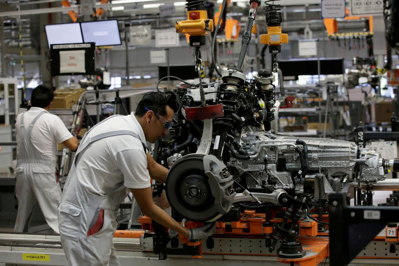 FILE PHOTO: Employees works at an Audi Q5 2.0 production line of the German car manufacturer's plant during a media tour in San Jose Chiapa