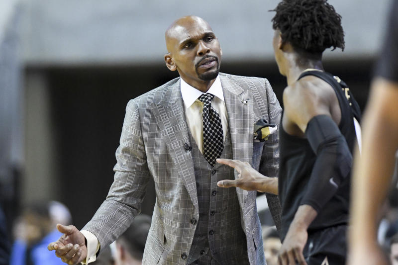 Vanderbilt coach Jerry Stackhouse talks with guard Saben Lee (0) during a timeout in the first half of the team's NCAA college basketball game against Auburn on Wednesday, Jan. 8, 2020, in Auburn, Ala. (AP Photo/Julie Bennett)