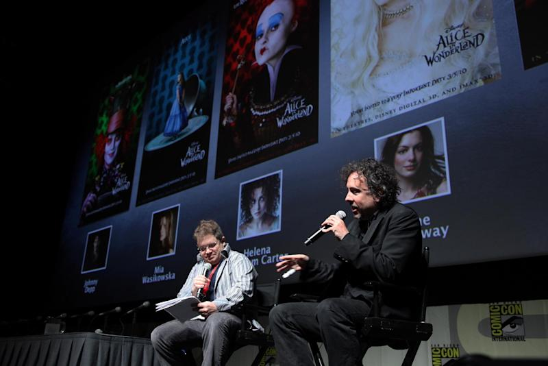 """FILE- This July 23, 2009 file photo shows Patton Oswalt and Director Tim Burton at the First-Ever 3D Panel featuring Disney's """"A Christmas Carol, Alice in Wonderland and Tron Legacy"""" at Comic-Con at the San Diego Convention Center in San Diego, Calif. Attending Comic-Con is often a once-in-a-lifetime opportunity for many con-goers, but it's just another summertime destination for the likes of """"The Wolverine"""" star Hugh Jackman, geeky funnyman Oswalt and """"The Amazing Spider-Man"""" sequel writers Alex Kurtzman and Roberto Orci. (Photo by Eric Charbonneau/Invision/AP Images, File)"""