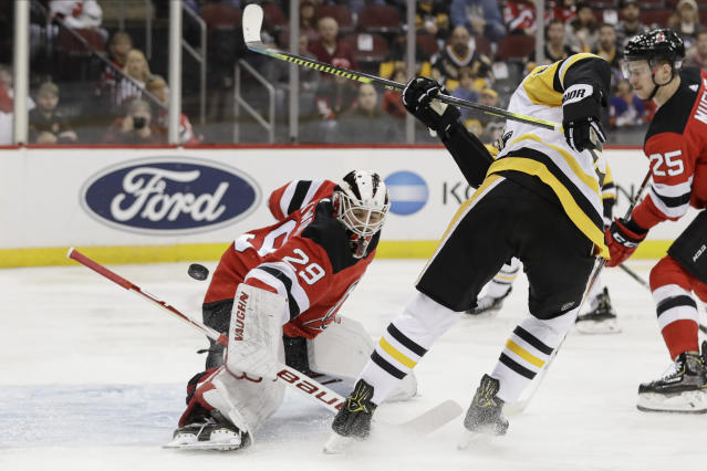 New Jersey Devils goaltender Mackenzie Blackwood (29) stops a shot by Pittsburgh Penguins' Nick Bjugstad (27) during the first period of an NHL hockey game Friday, Nov. 15, 2019, in Newark, N.J. (AP Photo/Frank Franklin II)