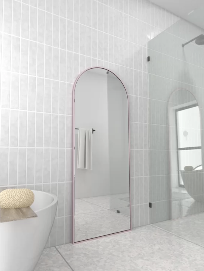 """An arched mirror is both classic and sophisticated, and this extra large one would make a beautiful addition to your home. It comes in four finishes—including a playful baby pink one—so you can find the one that best fits your taste. $340, Wayfair. <a href=""""https://www.wayfair.com/decor-pillows/pdp/glass-warehouse-modern-contemporary-full-length-mirror-gaks1945.html?piid=48939088%2C48939090"""" rel=""""nofollow noopener"""" target=""""_blank"""" data-ylk=""""slk:Get it now!"""" class=""""link rapid-noclick-resp"""">Get it now!</a>"""