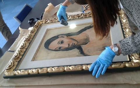 Pablo Picasso's 'Head of a Young Woman' was handed in to Spanish Authorities - Credit: STR/EPA/REX/Shutterstock