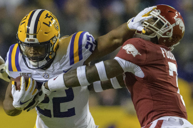LSU running back Clyde Edwards-Helaire (22) stiff arms Arkansas defensive back Joe Foucha (7) in an NCAA college football game in Baton Rouge, La., Saturday, Nov. 23, 2019. (AP Photo/Matthew Hinton)