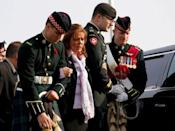Soldiers escort Kathy Cirillo (2nd L) during the funeral procession for her son Cpl. Nathan Cirillo in Hamilton, Ontario October 28, 2014. REUTERS/Mark Blinch