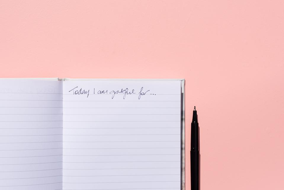Keeping a gratitude journal is one way to make time for peaceful reflection. (Photo: Getty Creative stock photo)