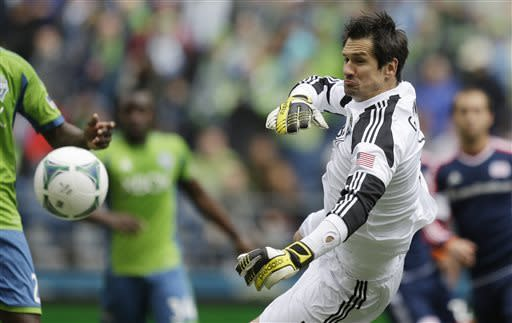 Seattle Sounders goalkeeper Michael Gspurning knocks a ball away during the first half of an MLS soccer match against the New England Revolution, Saturday, April 13, 2013, in Seattle. (AP Photo/Ted S. Warren)