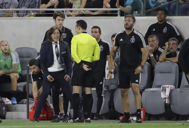 San Jose Earthquakes coach Matias Almeyda, left, argues a call with an official during the first half of the team's MLS soccer match against Los Angeles FC on Wednesday, Aug. 21, 2019, in Los Angeles. (AP Photo/Marcio Jose Sanchez)