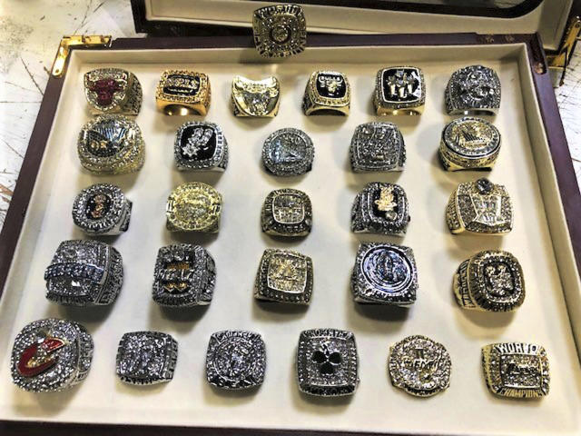 "The counterfeit ring collection included knock-offs of vintage rings and those won recently by the <a class=""link rapid-noclick-resp"" href=""/nba/teams/cleveland/"" data-ylk=""slk:Cavaliers"">Cavaliers</a> and <a class=""link rapid-noclick-resp"" href=""/nba/teams/golden-state/"" data-ylk=""slk:Warriors"">Warriors</a>. (AP)"