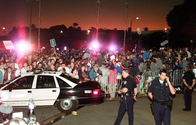 <p>A large crowd gathers outside Los Angeles County Superior Court Tuesday, Feb. 4, 1997, in Santa Monica, Calif., to hear the verdict in the wrongful-death civil trial against O.J. Simpson. Simpson was found liable in the deaths of Nicole Brown Simpson and Ron Goldman. (Photo: Mark J. Terrill/AP) </p>