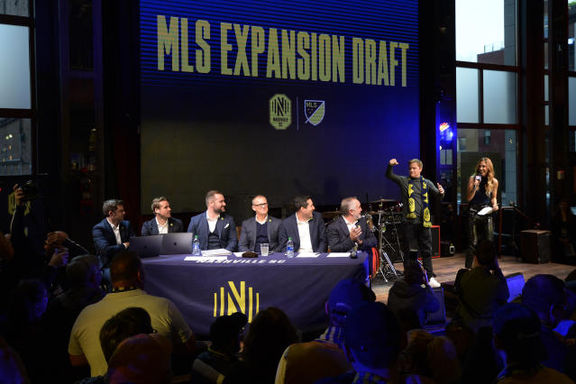 Nashville SC management, seated, wait to announce the player selections during the Major League Soccer expansion draft Tuesday, Nov. 19, 2019, in Nashville, Tenn. (AP Photo/Mark Zaleski)
