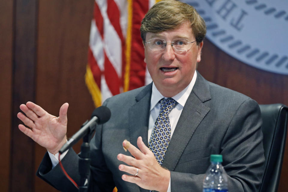 Mississippi Gov. Tate Reeves announces the launch of a workforce training program for workers impacted by COVID-19, during his coronavirus press briefing, in Jackson, Miss., Wednesday, Aug. 5, 2020. The ReSkill Mississippi Initiative is designed to help the economic issues brought on by the pandemic, by providing Mississippians who lost their jobs the opportunity to go through skills training at Mississippi community colleges. (AP Photo/Rogelio V. Solis)