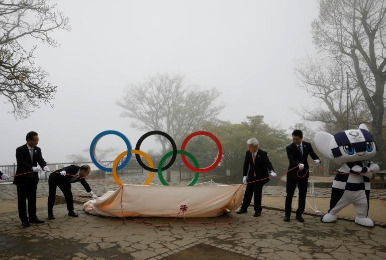 Officials unveiled Olympic Rings on Mount Takao, west of Tokyo, on Wednesday
