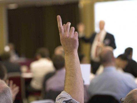 raising hand in class to ask question